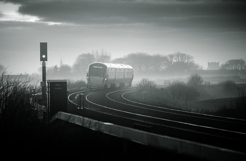 A evening Irish Rail train approaches Kildare on a misty winter's evening.