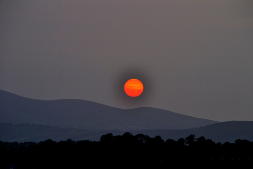The end of a perfect day, as the sun roll's down behind Slievenamon.