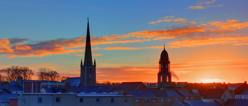 Skyline across the city of Lisburn showing the Cathedral and the Market House (Linen Centre) at sunrise