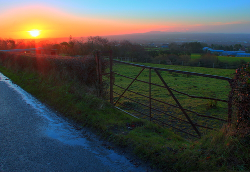 Sunrise across Lisburn with a view to the Mourne Mountains, from White Mountain (part of the Belfast Hills)