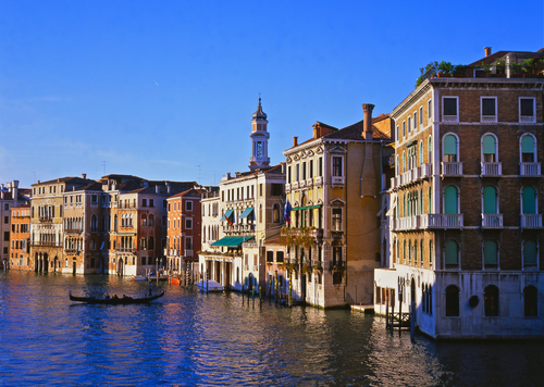 Evening view of the Grand Canal from the Rialto Bridge in Venice, Italy.