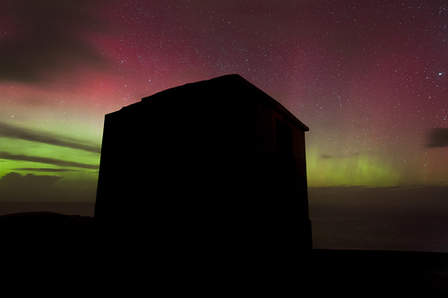 An old army building at Malin Head Co Donegal, with the Aurora Borealis in the background.