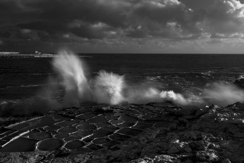 The coast of Marsaskala is surrounded by Salt Pans, carved by hand a long time ago. This image, shot during the last winter when the waves were very high, caught my eye, seeing that the wave itself looks like a Monster rising out of the sea.