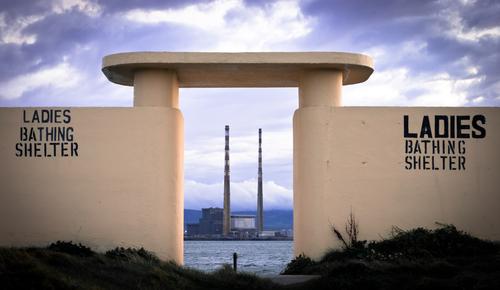Poolbeg Power Station in Dublin, seen from Bull Island across Dublin Bay.