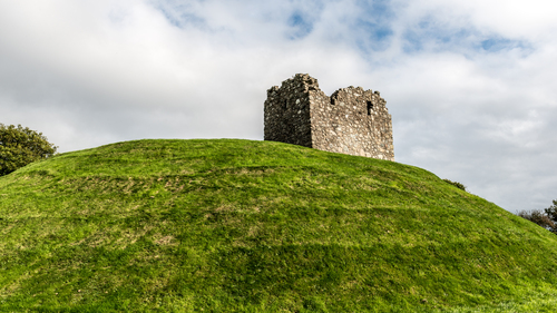 Clough Castle is the site of an Anglo-Norman Motte-and-bailey situated in Clough, County Down, Northern Ireland, near the junction of the A25 and A24 roads.
