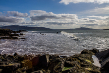 Waves coming in on Linsfort beach, looking back towards Buncrana, Inch, Rathmullen