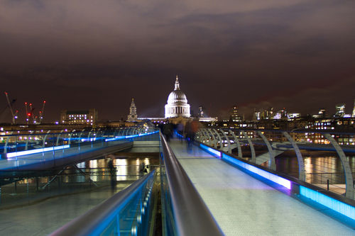 View of St. Paul's Cathedral from the Millennium Bridge at night.