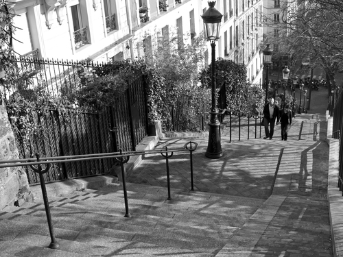 A romantic walk up one of the series of steps leading to the Sacre Coeur in Montmartre, Paris.