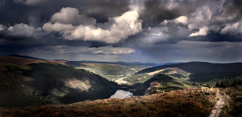 Glendalough sits serene in the valley as the cumulus legions march from the north-west, this time not bothering to stop and storm.