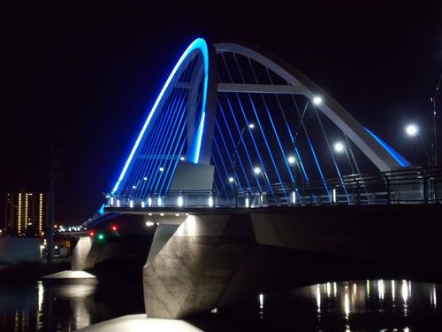 The Lowry Avenue Bridge shinning brightly through the night.