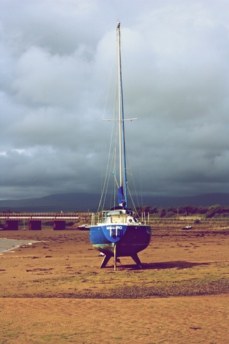 A lonesome boat awaits its owner in Ravenglass