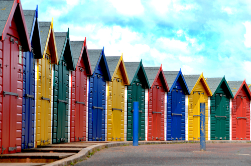 A row of empty beach huts on the seafront at Dawlish Warren
