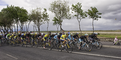 The Giro D'Italia Peloton Passes through Malahide with a Little Girl in the Lead