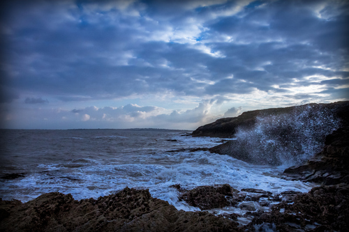 Donabate waves crashing on the rocks at sunset.
