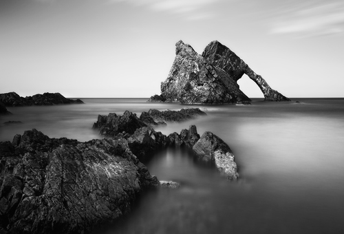 A mono image of Bow Fiddle Rock in Port Knockie in Scotland.