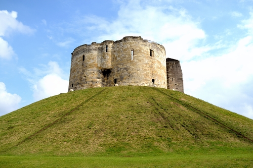 Clifford's Tower is a ruined keep just outside the center of the city of York in the United Kingdom. The keep can trace it's history back to the 11th century when York was a Viking capital. It was built to be the keep of York castle but now stands alone as a monument to part of the great history of this Yorkshire City.