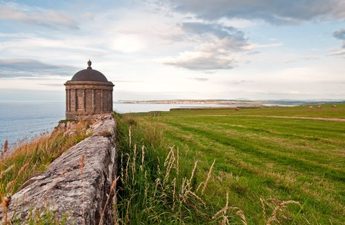 The beautiful folly that is Mussenden Temple hangs on to a cliff edge perched above the Atlantic Ocen at Castlerock on the Causeway Coast in northern Ireland.
