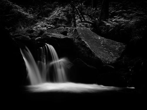 One of the many small waterfalls that Padley Brook has as the peaty water makes its way through