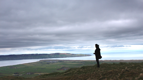 Looking from Binevenagh Mountain down to the shore and beyond to Donegal