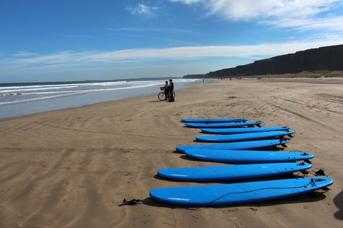 Surfboards on a spectacular day at Benone Beach, Limavady