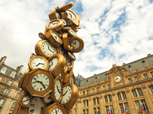'Time for All' clocks sculpture by Armand Fernandez at the Gare Saint Lazare train station in central Paris, France.