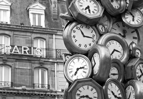 Close-up of the 'Time for All' sculpture by Armand Fernandez on the concourse in front of Gare Saint Lazare train station in central Paris, France.