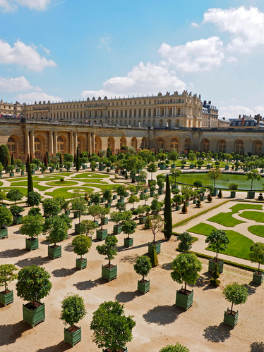 View over the Orangerie towards the Palace of Versailles west of Paris, France.