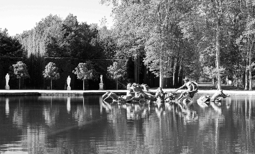 Black and white treatment of the Fountain of Apollo in the grounds of the Palace of Versailles.