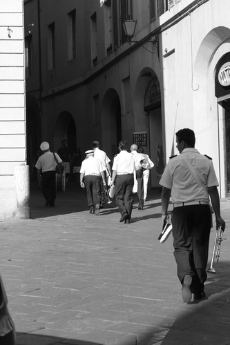 Photo taken at the ii palio race in Siena, Italy. The band had played all day in blistering heat. Just caught them leaving for home.
