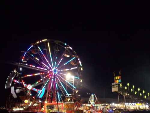 Ferris wheel and rides illuminated at night, Anoka County Fair.