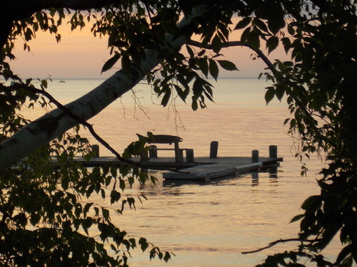A whimsical bench on a dock at sunset, Lake Mille Lacs.