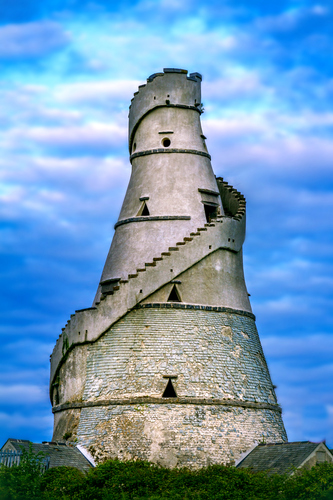 This unusual corkscrew shaped building was built in 1743 to close the vista to the east of Castletown. The only similar building in Ireland is the bottle-tower near Rathfarnham in Co. Dublin, also incidentally a Conolly estate. Built at a time of famine, it was used to store grain. A stone staircase winds around the outside leading to the top. Inside each floor has a hole in the centre allowing the grain to be passed through. Two smaller structures of a similar design, used as dovecotes stand behind the main barn structure. While the Barn closed the eastern vista, the vista to the west was closed by the Celbridge Charter school (c.1730), built from funds left in Speaker Conolly's will. It is now the Setanta House Hotel.