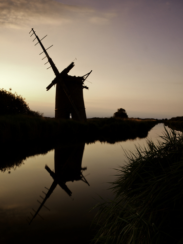 The now ruined remains of Brograve wind pump at the end of the day in the Norfolk broads.