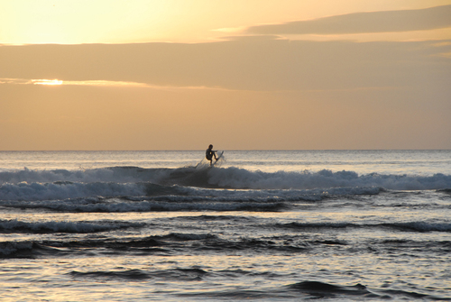 A surfer getting air at Ulu Watu, Bali.