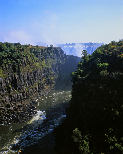 View of the Zambezi gorge and the Victoria Falls beyond from the bridge between Zambia and Zimbabwe.