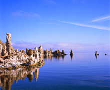 Morning view of the strange tufa rock formations reflected in the calm waters of Mono Lake in eastern California.