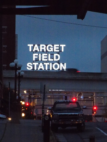 Target Field Station shines out above the elevated highway to downtown Minneapolis. Thousands of fans see this sign from cars and trains going to concerts & baseball games. Its powerful simplicity is sure to become a cherished part of many childhood memories.