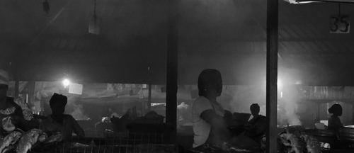 The community within Abacha Barracks, Abuja, Nigeria.  Smoke, noise, hustle, bustle and grilled croaker fish.
