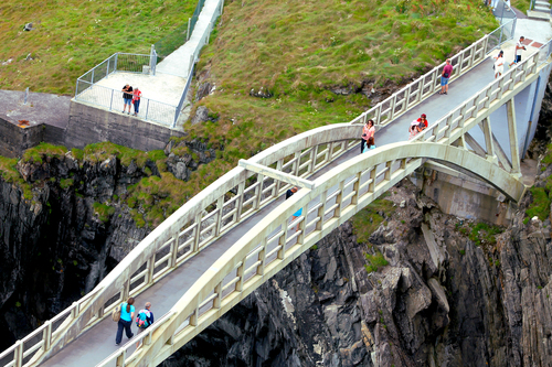 Crossing the foot bridge at Mizen Head West Cork.