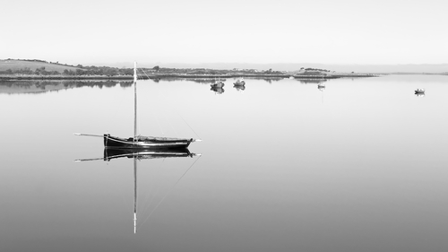 A very still morning at Kinvara. Hanorah, a Galway hooker, is a form of traditional fishing boat used in Galway Bay for at least 200 years.