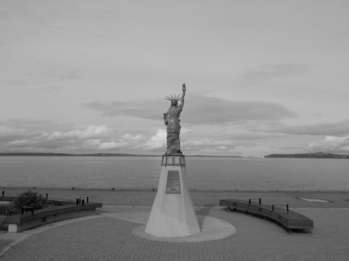 West Seattle - A small statue of liberty looks North out over Alki Beach & Puget Sound.