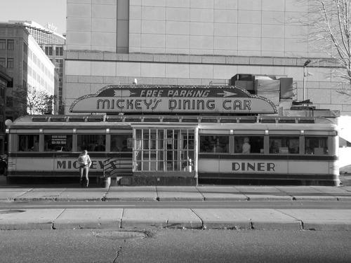 Woman standing outside Mickeys Dinning Car in Saint Paul, Minnesota.