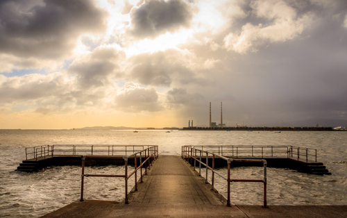 """The thermal station chimneys are among the tallest structures in Ireland and are visible from most of Dublin city. Number 1 chimney is 207.48m (680 ft 9in) high. Number 2 chimney is 207.8m (681 ft 9in) high. The chimneys are featured prominently in the video for the song """"Pride (In The Name Of Love)"""" by U2. Dublin City Councillor and historian Dermot Lacey began a process to list the chimneys for preservation to safeguard their future after the Station was to close in 2010."""