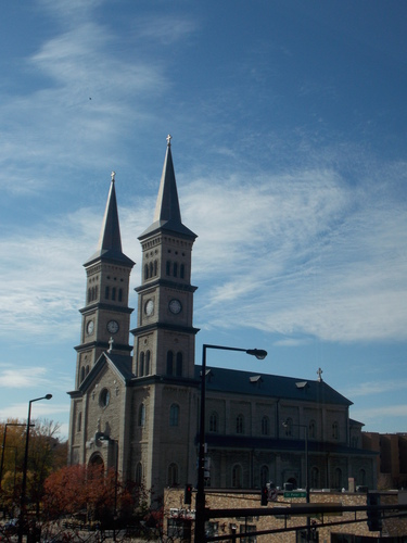 The Church of the Assumption sits in downtown Saint Paul. Founded in 1856, it stands out against he clear blue autumn skies.