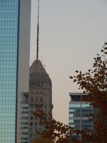 Autumn leaves contrast against the skylines of old & new in Minneapolis. Modern steel glass buildings surround the Foshay Tower that was completed in 1929.