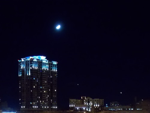 Grant Park Condominiums  and half moon on a clear night in Minneapolis.