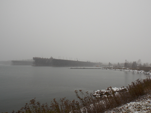 Through the snow Ore docks loom like battleships over Agate Bay in Two Harbors, Minnesota. Ore Dock #1 dates from 1911 and stands 75 feet above the water. Ore Dock #2 dates from 1916 and stands 80 feet above the water, both are over 1300 feet long.