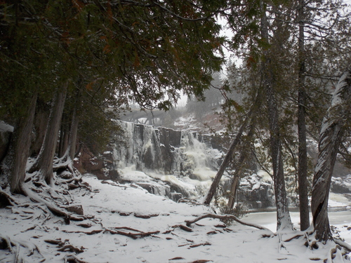 Winter comes suddenly to Gooseberry falls, freezing the falls and leaving a fresh blanket of snow on the ground.