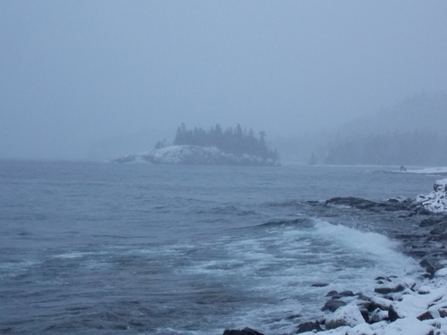 Snow & waves batter the shoreline of Lake Superior.