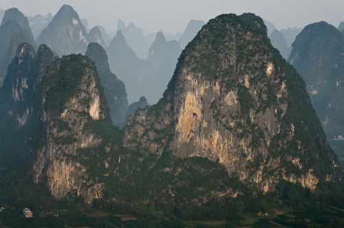 A view of the surreal limestone mountains known as the Karst Mountains in Mainland China.  My photo guide and I climbed approximately 1150 steep steps in the dark to reach the summit in time for the amazing sunrise.  These mountains surround the small rural town of Xingping, which is situated along one of the most beautiful stretches of the Li River in Guangxi Province near the city of Guilin.